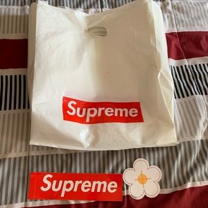 3 supreme bags and two supreme stickers